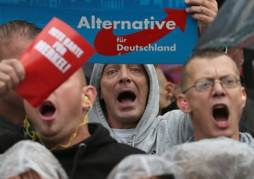 Supporters of the hard-right Alternative for Germany (AfD) party shout slogans durig an election campaign rally of German Chancellor Angela Merkel, a top candidate of the Christian Democratic Union Party (CDU) for the upcoming general elections in Torgau, Germany, September 6, 2017. REUTERS/Reinhard Krause