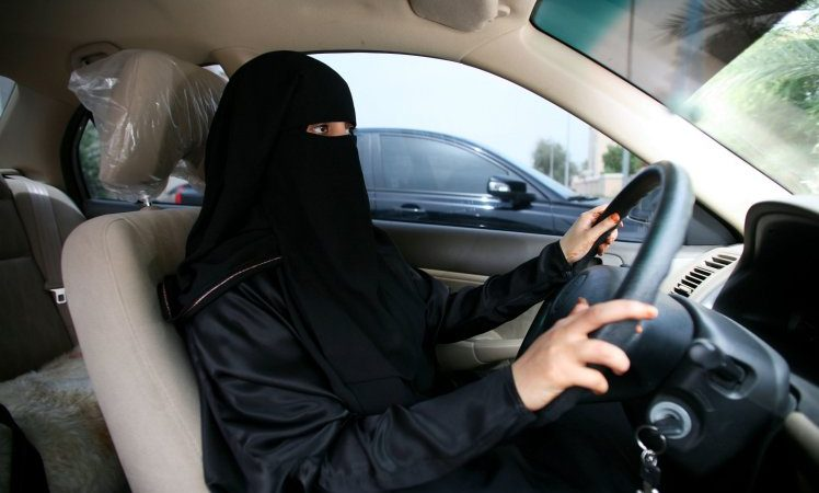 Mandatory Credit: Photo by REX/Shutterstock (993545e)  Emirati woman behind the wheel of her car  Abu Dhabi, United Arab Emirates - Jul 2009