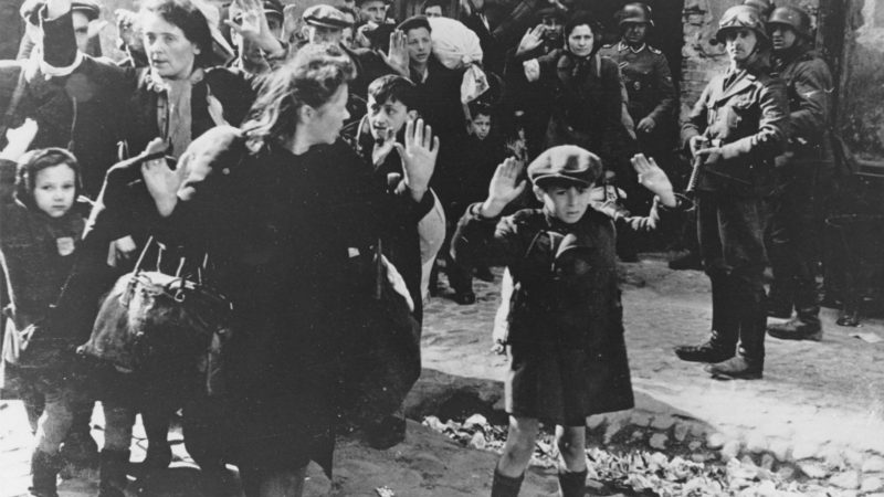 ** FILE ** In this April 19, 1943 file photo, a group of Jews, including a small boy, is escorted from the Warsaw Ghetto by German soldiers. The family of a Polish social worker Irena Sendler who is credited with rescuing 2,500 Jewish children from the Nazis during the Holocaust says she has died.  Sendler's daughter, Janina Zgrzembska, says her 98-year-old mother died Monday, May 12, 2008, morning in a Warsaw hospital. Sendler organized the rescue of Jewish children from the Warsaw Ghetto during Nazi Germany's brutal World War II occupation. (AP Photo)