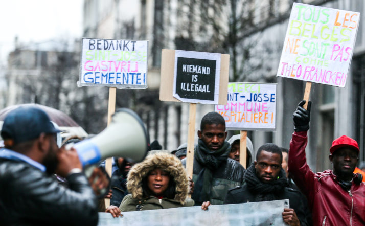 epa06416134 Undocumented immigrants gather to protest, in Brussels,  Belgium, 04 January 2018, against the migration policy of the Belgian Secretary of State for Immigration, Theo Franken and to thank the municipality of Saint-Josse which gives them a roof for three years.  EPA-EFE/STEPHANIE LECOCQ