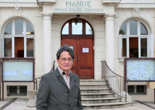 (FILES) This file photo taken on July 10, 2014 shows French right-wing UMP party mayor of Wissous, Richard Trinquier, posing in front of the town hall in Wissous, near Paris. Trinquier was put into custody  after he threatened Roma people, according to Evry's prosecution on April 8, 2018. / AFP PHOTO / JACQUES DEMARTHON